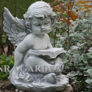 Figura aniołka z książką
