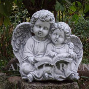 Figura dwóch aniołków z książką